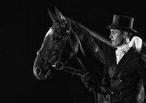 Eventer with horse in dressage top hat and tails